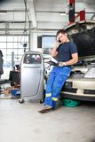 Mechanic Talking on Phone Stock Photography