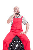 Mechanic talking on the phone Stock Photography