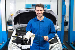 Mechanic testing oil in car Stock Photo