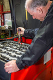 Mechanic tests the battery acid Royalty Free Stock Photo