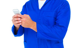 Mechanic text messaging through mobile phone Royalty Free Stock Photography