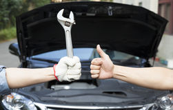 mechanic with thumbs up and tool royalty free stock images