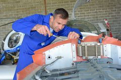 Mechanic tightening on aircraft royalty free stock image