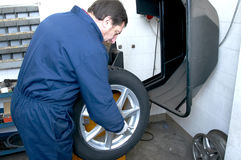 Mechanic and tire Stock Photo
