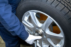 Mechanic and tire Stock Photography