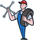 Mechanic With Tire Socket Wrench And Tire Stock Photography