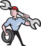 Mechanic With Tire Socket Wrench And Tire Royalty Free Stock Photography