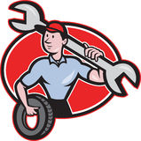 Mechanic With Tire Socket Wrench And Tire Royalty Free Stock Images