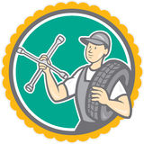 Mechanic With Tire Wrench Rosette Cartoon Stock Image