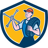Mechanic With Tire Wrench Shield Cartoon Stock Photo