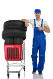 Mechanic with tires giving a thumbs up Stock Image