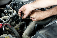 Mechanic with tools. A mechanic working on an engine royalty free stock image