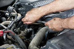 Mechanic with tools. A mechanic working on an engine royalty free stock photos