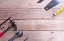 Mechanic tools set or Assorted work tools on wooden background stock photo