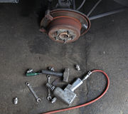 Mechanic tools to fix  disk brake. Without tire Stock Images