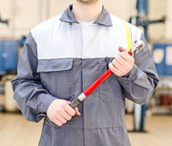 Mechanic with torque wrench. Royalty Free Stock Images