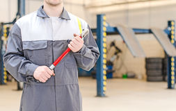 Mechanic with torque wrench. Mechanic with torque wrench at auto repair shop Stock Photography