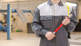 Mechanic with torque wrench. Royalty Free Stock Image