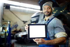 Mechanic with touchpad Royalty Free Stock Photos