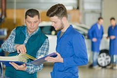 Mechanic trying to find clients records royalty free stock photography