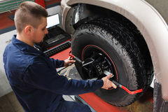Mechanic tuning aligner for wheel alignment Royalty Free Stock Images