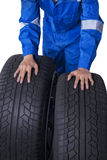 Mechanic with two black tires Stock Image