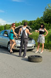 Mechanic and two girls Royalty Free Stock Image