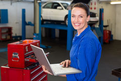 Mechanic typing on a laptop Stock Image