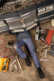 Mechanic under the car royalty free stock photos