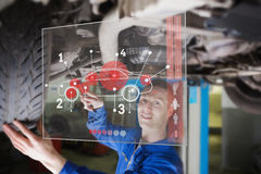 Mechanic under car consulting interface Stock Image