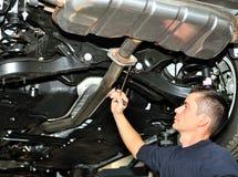 Mechanic under car. Royalty Free Stock Photo