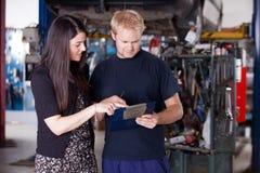 Mechanic with Upset Customer Royalty Free Stock Image