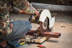 Mechanic use cut off saw machine cutting steel Royalty Free Stock Photos