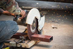 Mechanic use cut off saw machine cutting steel Stock Image