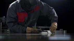 Mechanic uses welding machine. Man using welding machine to fix the door handle stock video footage