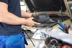 Mechanic using a Diagnostic Tool Royalty Free Stock Photo