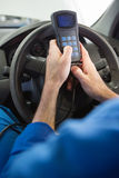 Mechanic using diagnostic tool in the car Stock Photos