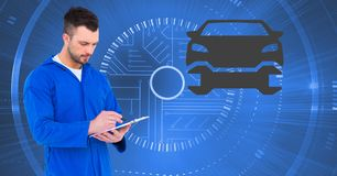 Mechanic using digital tablet against car mechanic interface in background. Digital composite image of mechanic using digital tablet against car mechanic Stock Photography