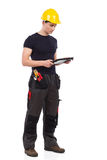 Mechanic using a digital tablet Royalty Free Stock Image