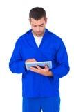 Mechanic using digital tablet on white background. Male mechanic using digital tablet on white background Stock Photos