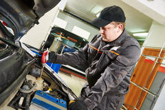 Mechanic using a hydrometer to check the antifreeze Royalty Free Stock Photos
