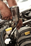 Mechanic using impact wrench for engine Royalty Free Stock Image