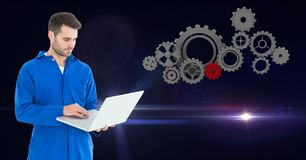 Mechanic using laptop Stock Images