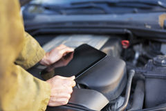 Mechanic using tablet computer Stock Images