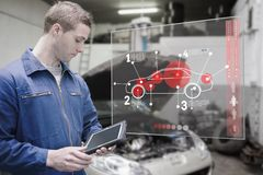 Mechanic using tablet and futuristic interface Royalty Free Stock Image