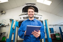 Mechanic using a tablet pc Stock Photos