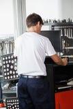 Mechanic Using Wheel Alignment Machine Stock Images