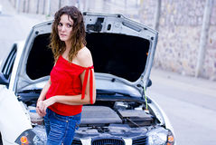 Mechanic waiting. Sad Woman waiting for mechanic to repair her car Stock Images