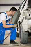 Mechanic welding car body Stock Photo