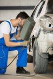 Mechanic welding car body Stock Photo